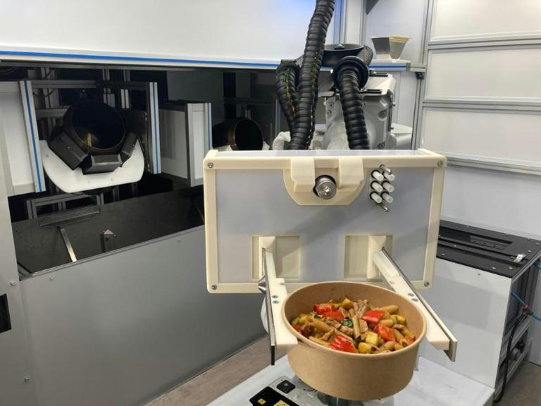 An automated kitched developed by the startup RoboEatz and launching at the 2021 Consumer Electronics Show prepares, cooks and serves an array of hot and cold food dishes from soups to salads to meal bowls