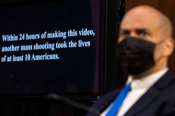 PHOTO: Sen. Cory Booker looks on as a video highlighting recent mass shootings in America is played during the Senate Judiciary Committee hearing at the Capitol in Washington on March 23, 2021. (Caroline Brehman/CQ-Roll Call, Inc via Getty Images)