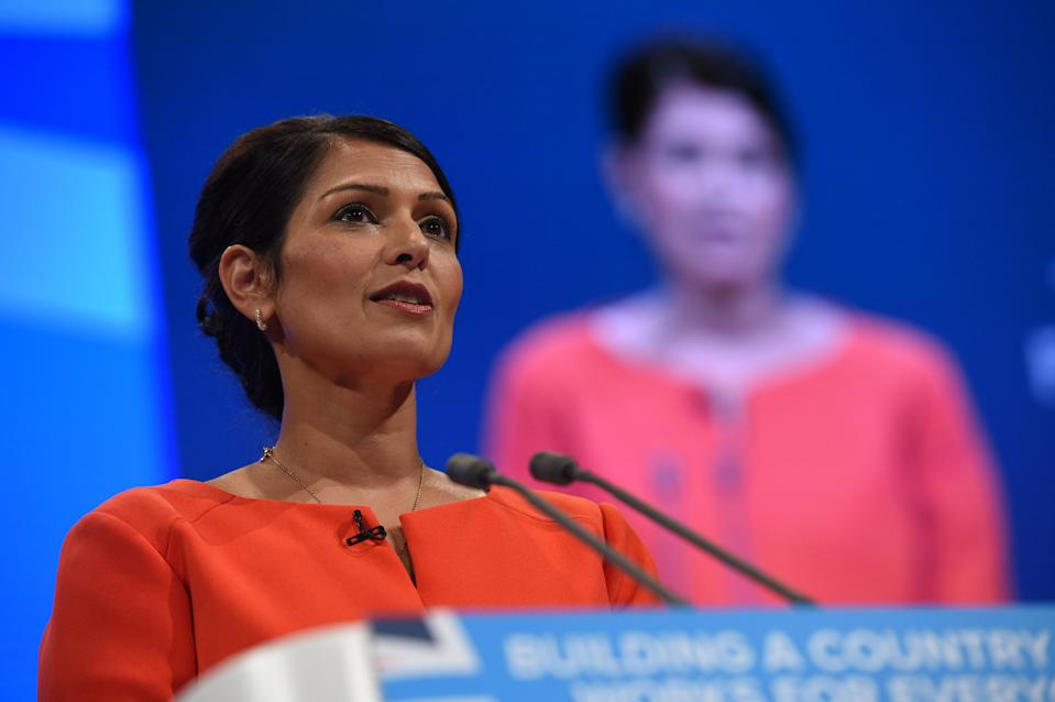 Britain's International Development Secretary Priti Patel delivers her speech on the third day of the Conservative Party annual conference at the Manchester Central Convention Centre in Manchester on October 3, 2017. / AFP PHOTO / Oli SCARFF (Photo credit should read OLI SCARFF/AFP via Getty Images)
