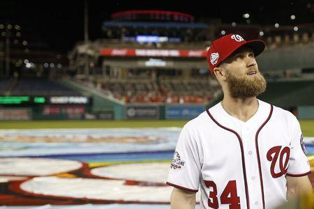 FILE PHOTO: Sep 26, 2018; Washington, DC, USA; Washington Nationals right fielder Bryce Harper (34) looks into the stands while standing on the field after the Nationals' game against the Miami Marlins was called for rain in the eighth inning at Nationals Park in what may be his final home game for the Nationals. Mandatory Credit: Geoff Burke-USA TODAY Sports