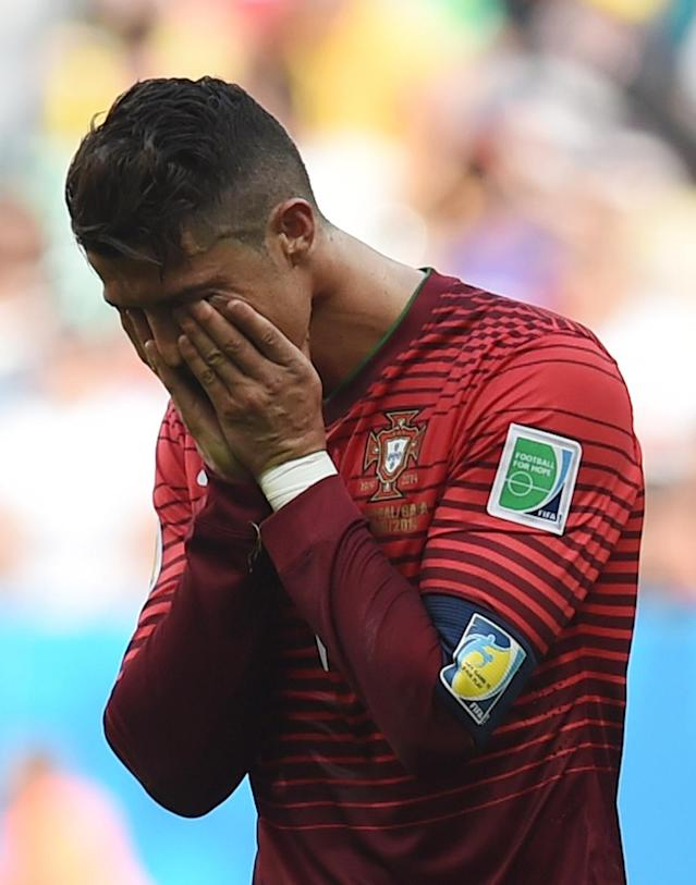 Portugal's Cristiano Ronaldo reacts during the group G World Cup soccer match between Portugal and Ghana at the Estadio Nacional in Brasilia, Brazil, Thursday, June 26, 2014. Portugal won 2-1 but were eliminated from the competition. (AP Photo/Paulo Duarte)