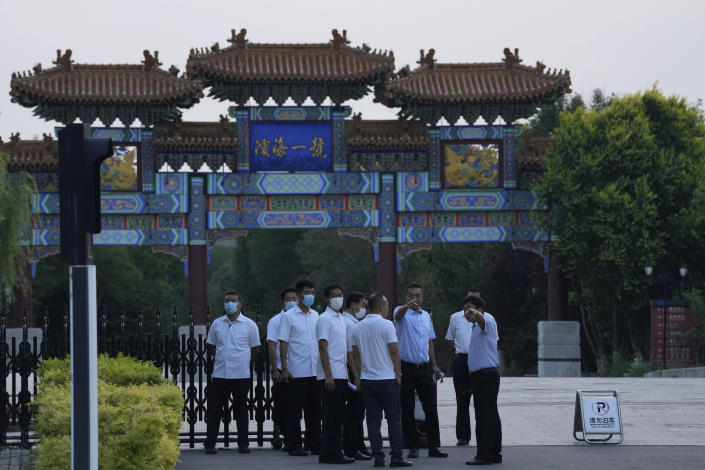 A member of security personnel gestures towards journalists outside the Tianjin Binhai No. 1 Hotel where U.S. and Chinese officials are expected to hold talks in Tianjin municipality in China on Sunday, July 25, 2021. Deputy Secretary of State Wendy Sherman travelled to China this weekend on a visit that comes as tensions between Washington and Beijing soar on multiple fronts, the State Department said Wednesday. (AP Photo/Ng Han Guan)