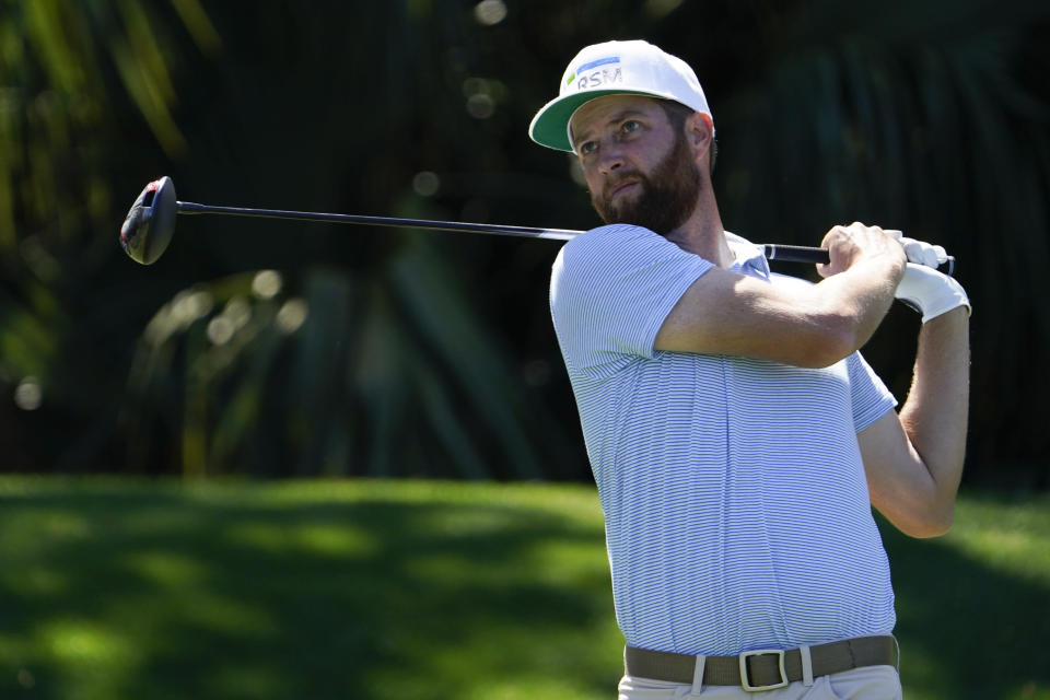 Chris Kirk watches his tee shot on the seventh hole during the second round of the The Players Championship golf tournament Friday, March 12, 2021, in Ponte Vedra Beach, Fla. (AP Photo/John Raoux)