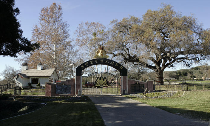 FILE - This Dec. 17, 2004, file photo shows the rear entrance to pop star Michael Jackson's Neverland Ranch home in Santa Ynez, Calif. Jackson's Neverland Ranch has found a new owner in billionaire businessman Ron Burkle. Burkle's spokesman said in an email Thursday, Dec. 24, 2020, that Burkle bought the 2,700-acre property near Santa Barbara, California. (AP Photo/Mark J. Terrill, file)