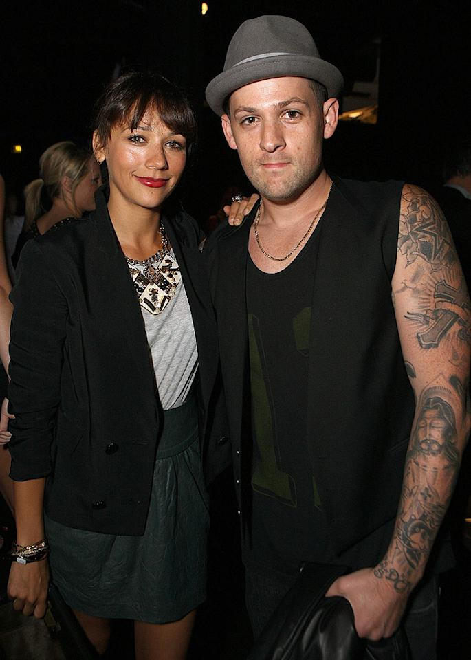 "Sporting a boyfriend blazer, leather tulip skirt, and a funky statement necklace, Rashida Jones cozied up to her good buddy, rocker Joel Madden. Chris Weeks/<a href=""http://www.wireimage.com"" target=""new"">WireImage.com</a> - August 11, 2010"