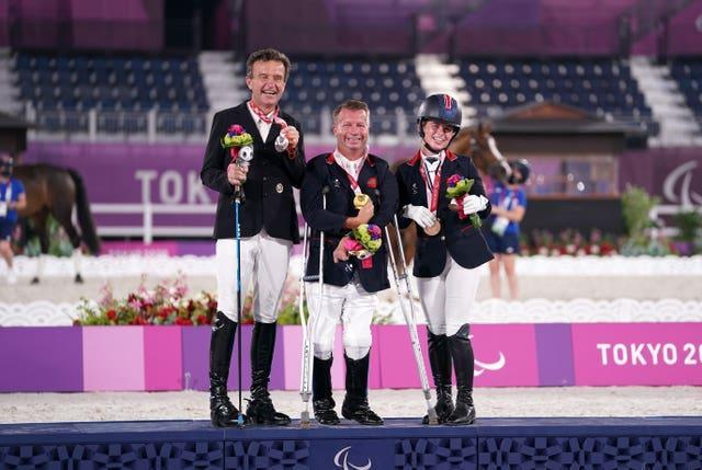 Sir Lee Pearson (centre) with his gold medal after winning the dressage individual (grade two) alongside second-placed Austria's Pepo Such and third placed ParalympicsGB team-mate Georgia Wilson