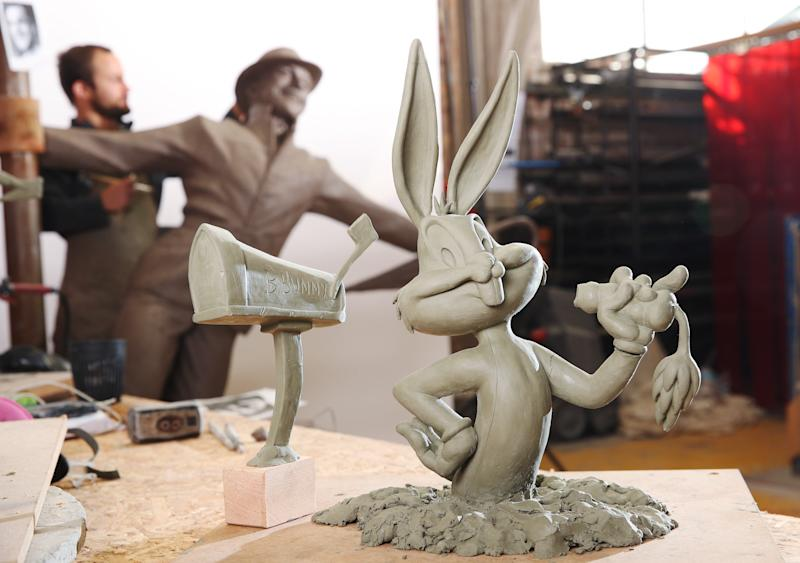 Sculptor Andrzej Szymczyk adds finishing touches to statues of Bugs Bunny and Gene Kelly, which will soon be installed around Leicester Square gardens.