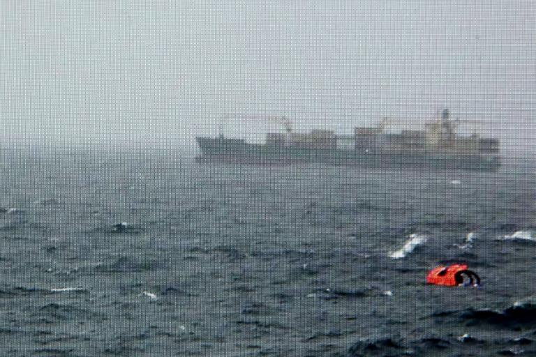 """A photo grabbed from the Greek television channel """"Skai"""" shows a life raft from the burning Italian-flagged """"Norman Atlantic"""" ferry, on December 28, 2014"""