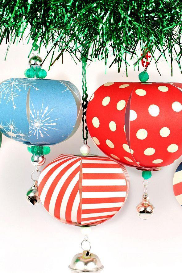 """<p>Crafted from scrapbook paper, string, and wire, these colorful creations cost next to nothing to make.</p><p><strong>Get the tutorial at <a href=""""http://www.markmontano.com/2016/11/paper-christmas-ornaments.html"""" rel=""""nofollow noopener"""" target=""""_blank"""" data-ylk=""""slk:Make Your Mark"""" class=""""link rapid-noclick-resp"""">Make Your Mark</a>.</strong></p><p><strong><a class=""""link rapid-noclick-resp"""" href=""""https://www.amazon.com/Penny-Black-80-013-Holiday-Trimmings/dp/B015HIPB2G/?tag=syn-yahoo-20&ascsubtag=%5Bartid%7C10050.g.1070%5Bsrc%7Cyahoo-us"""" rel=""""nofollow noopener"""" target=""""_blank"""" data-ylk=""""slk:SHOP SCRAPBOOK PAPER"""">SHOP SCRAPBOOK PAPER</a><br></strong></p>"""