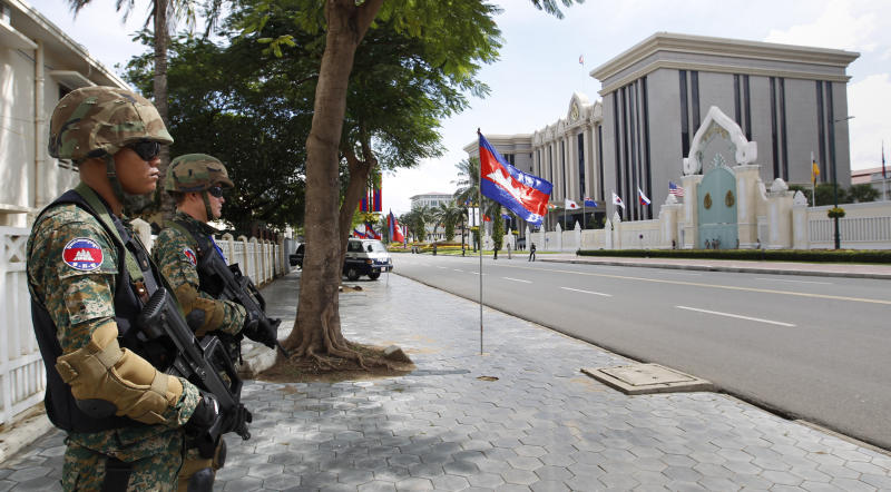 Heavily-armed Cambodian police special force officers stands guard in front of the Peace Palace ahead of the 21st of ASEAN Summit and related meetings in Phnom Penh, Cambodia, Saturday, Nov. 17, 2012. (AP Photo/Vincent Thian)