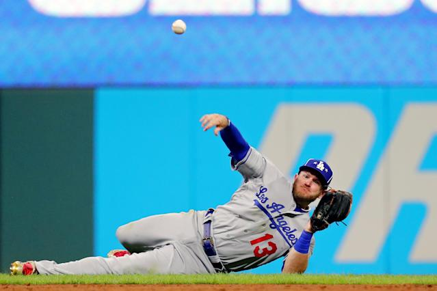 Max Muncy #13 of the Los Angeles Dodgers thorws to first base for the out during the 90th MLB All-Star Game at Progressive Field on Tuesday, July 9, 2019 in Cleveland, Ohio. (Photo by Alex Trautwig/MLB Photos via Getty Images)