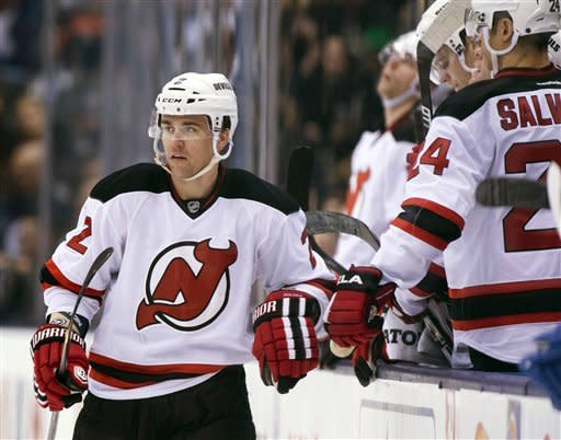 New Jersey Devils defenseman Marek Zidlicky is congratulated by teammates after scoring on the Toronto Maple Leafs during the second period of their NHL hockey game, Monday, March 4, 2013, in Toronto. (AP Photo/The Canadian Press, Frank Gunn)