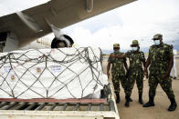 Malawian police guard AstraZeneca COVID-19 vaccines after the shipment arrived at the Kamuzu International Airport in Lilongwe, Malawi, Friday March 5, 2021. The country is the latest in Africa to receive vaccines in a fight against COVID-19. (AP Photo/Thoko Chikondi)
