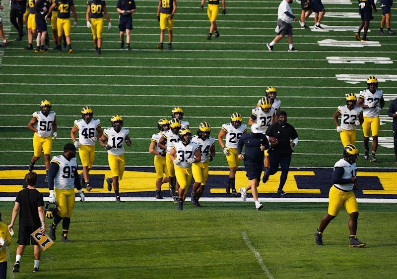 University of Michigan football players run drills on the practice field at the University of Michigan in Ann Arbor on Wednesday, September 16, 2020.