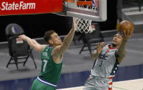 Washington Wizards guard Bradley Beal (3) goes up to shoot as Dallas Mavericks center Dwight Powell (7) defends during the second half of an NBA basketball game Saturday, May 1, 2021, in Dallas. (AP Photo/Ron Jenkins)
