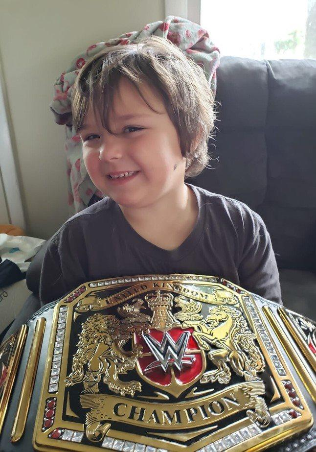 Timmy Vick, a 5-year-old autistic boy from Delaware, likes to sleep with his replica WWE belt at night. (Credit: Sergio Moreira)