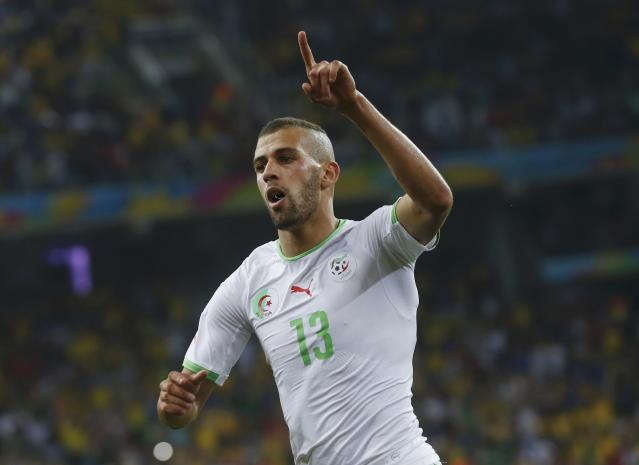 Algeria's Islam Slimani celebrates after scoring a goal during their 2014 World Cup Group H soccer match against Russia at the Baixada arena in Curitiba June 26, 2014. REUTERS/Maxim Shemetov (BRAZIL - Tags: SOCCER SPORT WORLD CUP)