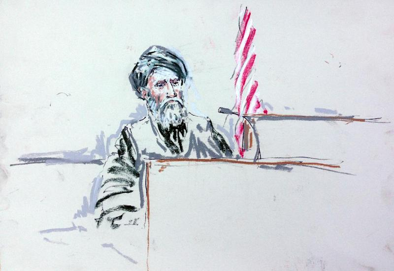CORRECTS SPELLING OF ARTIST'S LAST NAME TO MILLETT INSTEAD OF MILLET - In this courtroom sketch, Haji Mohammad Naim testifies Tuesday, Aug. 20, 2013, in a courtroom at Joint Base Lewis-McChord south of Seattle. Naim, an Afghan farmer shot during a massacre in Kandahar Province last year, took the witness stand Tuesday at a sentencing hearing for Staff Sgt. Robert Bales, who attacked his village and one other in pre-dawn raids on March 11, 2012, killing 16 civilians. Naim cursed Bales him before breaking down and pleading with the prosecutor not to ask him any more questions. (AP Photo/Peter Millett)