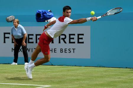 FILE PHOTO: Tennis - ATP 500 - Fever-Tree Championships - The Queen's Club, London, Britain - June 19, 2018 Serbia's Novak Djokovic in action during his first round match against Australia's John Millman Action Images via Reuters/Tony O'Brien
