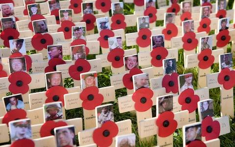 Pictures of soldiers who have died in the Afghanistan conflict on crosses in the Royal Wootton Bassett Field of Remembrance at Lydiard park, Swindon - Credit:  Ben Birchall/PA