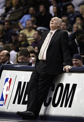 Denver Nuggets coach George Karl looks in the direction of the scoreboard during the first quarter of a NBA game against the Memphis Grizzlies in Denver on Friday, Dec. 14, 2012.(AP Photo/Joe Mahoney)