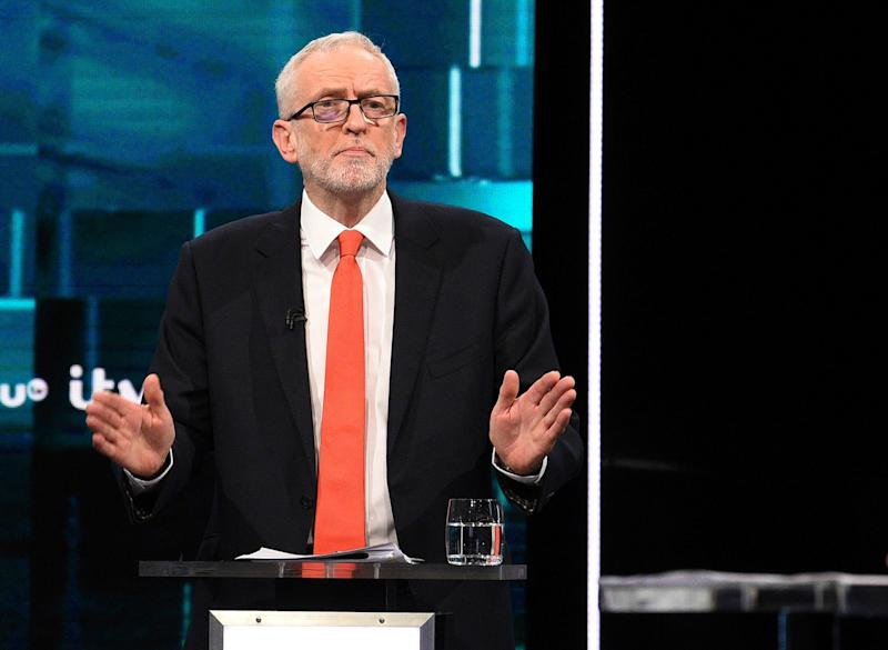 Jeremy Corbyn speaks during his head-to-head TV clash with Boris Johnson on ITV (AP)