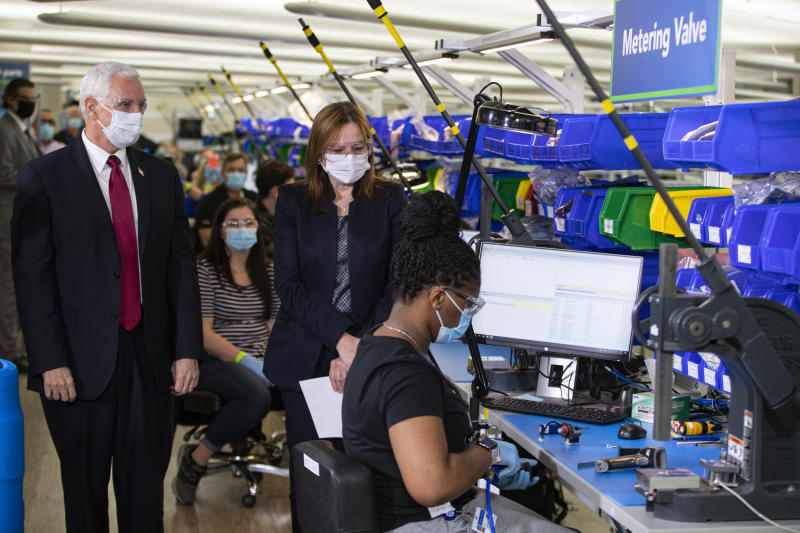 FILE - In this April 30, 2020, file photo Vice President Mike Pence tours the General Motors/Ventec ventilator production facility with GM CEO and Chairman Mary Barra in Kokomo, Ind. (AP Photo/Michael Conroy, File)