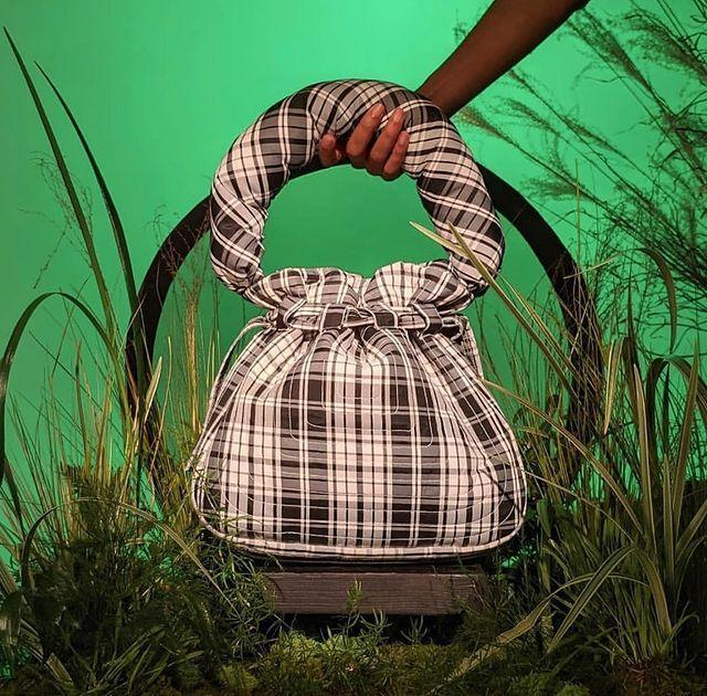 """<p>Created by sister duo, Darlene and Lizzy Okpo, the William Okpo brand has found the perfect balance of tasteful nostalgia. The gorgeous puffer bucket bag is the next item I'll be adding to my digital shopping cart. </p><p><a class=""""link rapid-noclick-resp"""" href=""""https://williamokpo.com/"""" rel=""""nofollow noopener"""" target=""""_blank"""" data-ylk=""""slk:SHOP NOW"""">SHOP NOW</a></p><p><a href=""""https://www.instagram.com/p/CLhCq_VhXfu/"""" rel=""""nofollow noopener"""" target=""""_blank"""" data-ylk=""""slk:See the original post on Instagram"""" class=""""link rapid-noclick-resp"""">See the original post on Instagram</a></p>"""