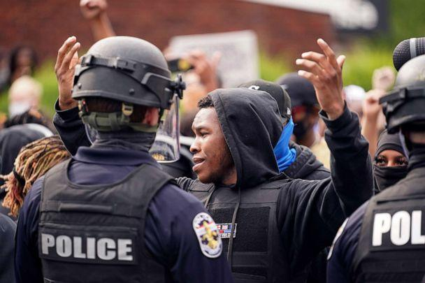 PHOTO: Police stand guard as people react after a decision in the criminal case against police officers involved in the death of Breonna Taylor, Sept. 23, 2020, who was shot dead by police in her apartment, in Louisville, Ky. (Bryan Woolston/Reuters)