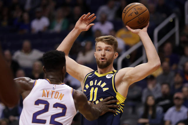 Indiana Pacers forward Domantas Sabonis (11) looks to pass over Phoenix Suns center Deandre Ayton (22) during the first half of an NBA basketball game, Wednesday, Jan. 22, 2020, in Phoenix. (AP Photo/Matt York)
