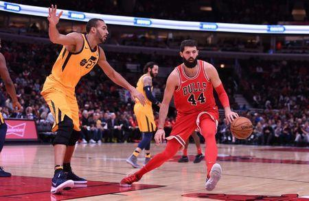 Dec 13, 2017; Chicago, IL, USA; Chicago Bulls forward Nikola Mirotic (44) dribbles the ball as Utah Jazz center Rudy Gobert (27) defends during the first half at the United Center. Mike DiNovo-USA TODAY Sports