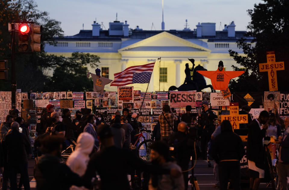 Demonstrators gather in Black Lives Matter Plaza while waiting for election results, Thursday, Nov. 5, 2020, in Washington. (AP Photo/Alex Brandon)