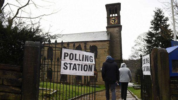 PHOTO: Residents arrive to vote at a polling station in Dobcross, northwest England, as Britain holds a general election on Dec. 12, 2019. (Oli Scarff/AFP via Getty Images)