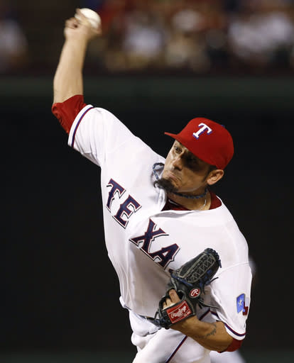 Texas Rangers starting pitcher Matt Garza throws to the New York Yankees during the eighth inning of a baseball game, Wednesday, July 24, 2013, in Arlington, Texas. (AP Photo/Jim Cowsert)