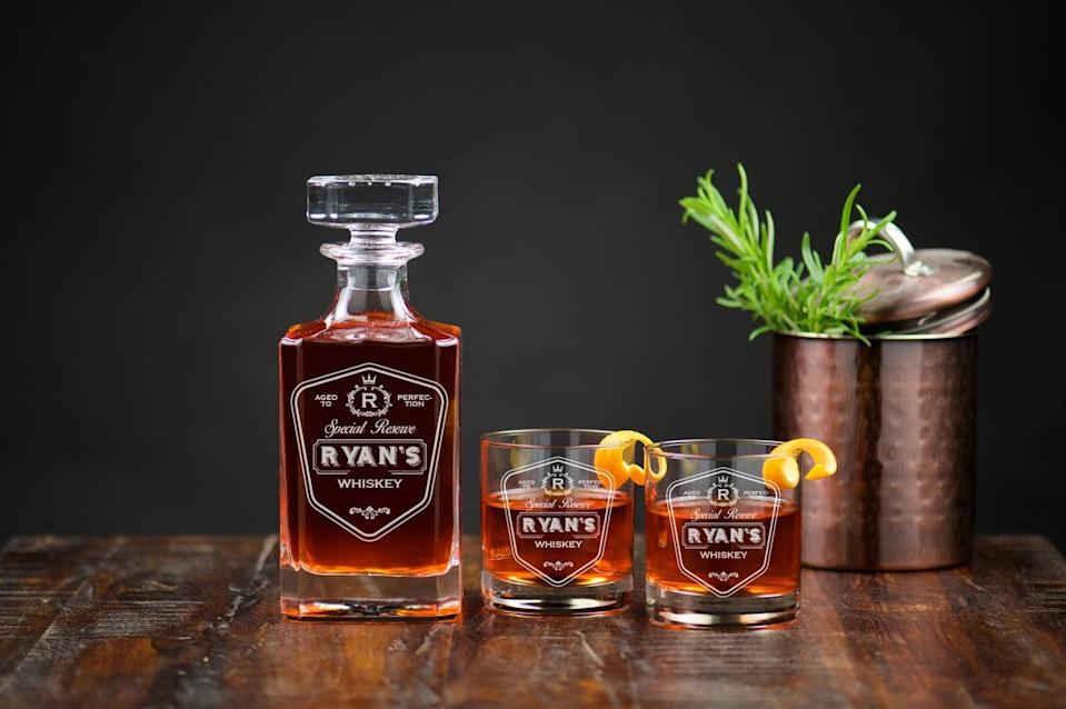 <p>Upgrade his bar with this personable <span>Engraved Decanter Set with Glasses Dad's Whiskey</span> ($40, and up). </p>