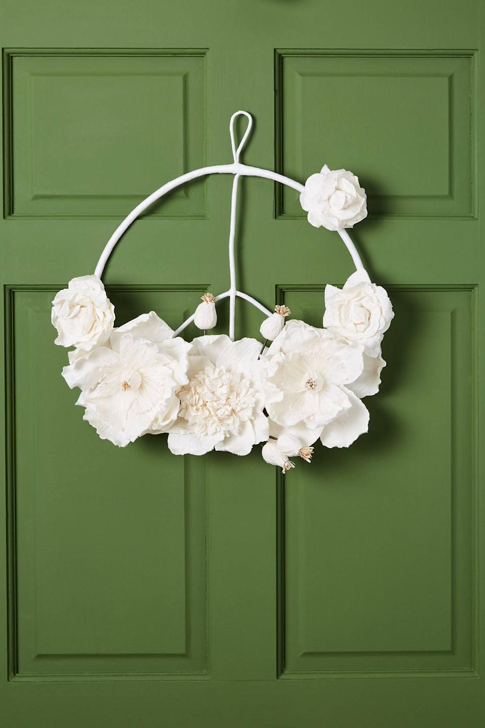 """<p>Give guests a warm welcome with the <a href=""""https://www.popsugar.com/buy/Peace-Sign-Wreath-490520?p_name=Peace%20Sign%20Wreath&retailer=anthropologie.com&pid=490520&price=68&evar1=casa%3Aus&evar9=46615300&evar98=https%3A%2F%2Fwww.popsugar.com%2Fhome%2Fphoto-gallery%2F46615300%2Fimage%2F46615390%2FPeace-Sign-Wreath&list1=shopping%2Canthropologie%2Choliday%2Cchristmas%2Cchristmas%20decorations%2Choliday%20decor%2Chome%20shopping&prop13=mobile&pdata=1"""" rel=""""nofollow noopener"""" class=""""link rapid-noclick-resp"""" target=""""_blank"""" data-ylk=""""slk:Peace Sign Wreath"""">Peace Sign Wreath</a> ($68).</p>"""