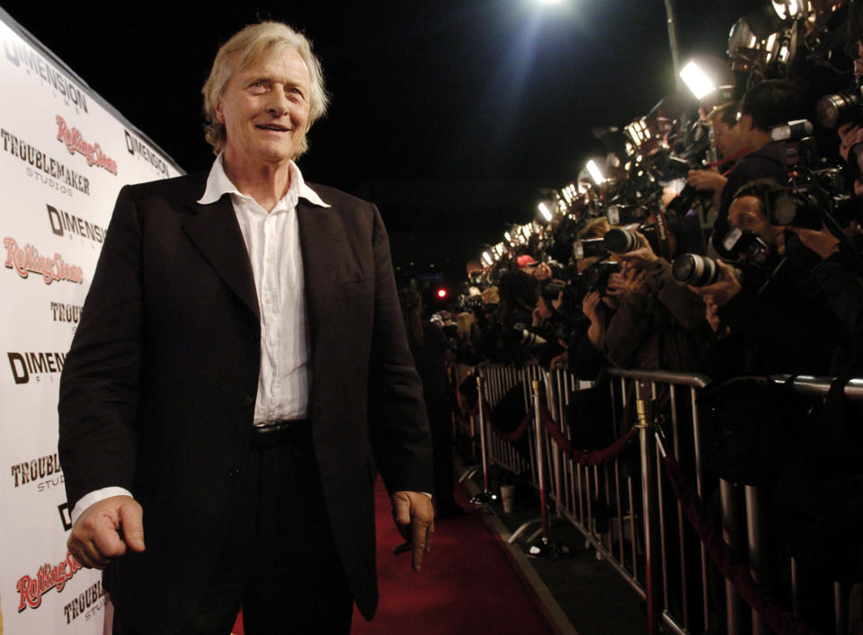 """FILE - This March 28, 2005 file photo shows Dutch actor Rutger Hauer arriving at the premiere of """"Sin City"""" in Los Angeles. Hauer, who specialized in menacing roles, including a memorable turn as a murderous android in """"Blade Runner"""" opposite Harrison Ford, has died July 19 at his home in the Netherlands. He was 75. (AP Photo/Chris Pizzello, File)"""
