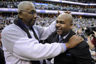 FILE - In this March 9, 2013, file photo, former Georgetown coach John Thompson Jr., left, congratulates his son Georgetown head coach John Thompson III, right, after the Hoya's 61-39 win over Syracuse in an NCAA college basketball game in Washington. John Thompson, the imposing Hall of Famer who turned Georgetown into a Hoya Paranoia powerhouse and became the first Black coach to lead a team to the NCAA mens basketball championship, has died. He was 78 His death was announced in a family statement Monday., Aug. 31, 2020. No details were disclosed. (AP Photo/Nick Wass, File)
