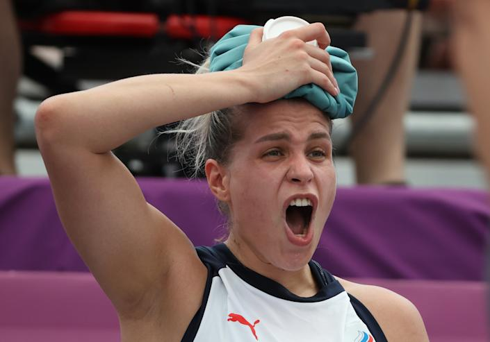 <p>ROC Team's Olga Frolkina uses an ice pack on her head in the women's 3x3 basketball pool round match against Japan during the 2020 Summer Olympic Games at Aomi Urban Sports Park. Stanislav Krasilnikov/TASS (Photo by Stanislav Krasilnikov\TASS via Getty Images)</p>