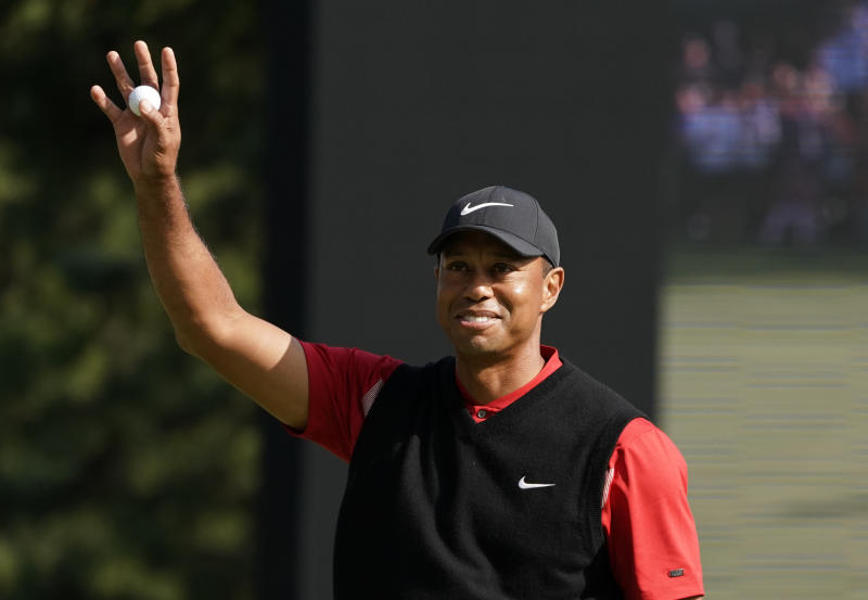 Tiger Woods of the United States reacts after his putt on the 18th hole during the final round of the Zozo Championship PGA Tour at the Accordia Golf Narashino country club in Inzai, east of Tokyo, Japan, Monday, Oct. 28, 2019. (AP Photo/Lee Jin-man)