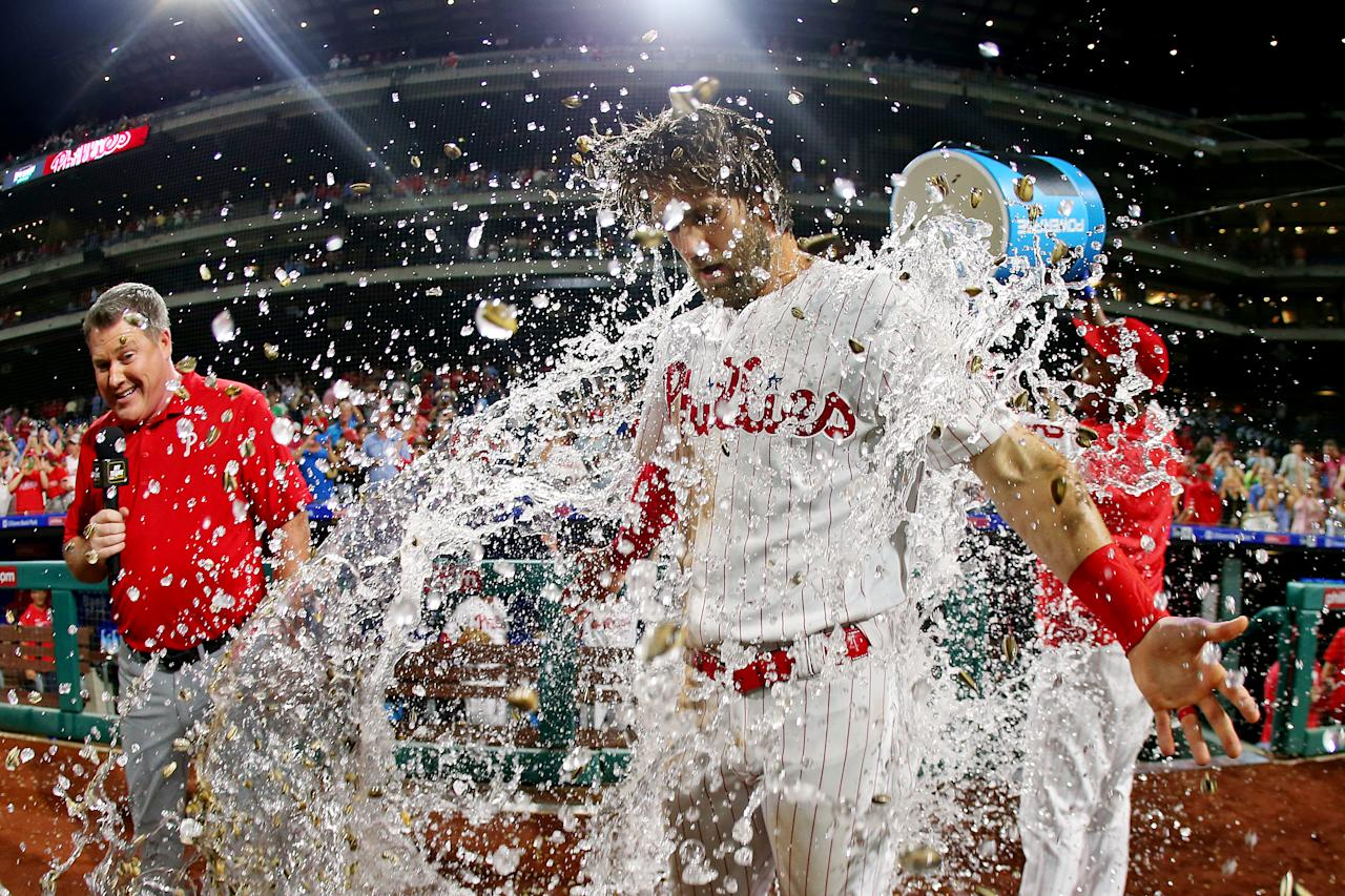 Bryce Harper #3 of the Philadelphia Phillies is doused with water by teammate Jean Segura #2 after hitting a walk-off two run double in the ninth inning to defeat the Los Angeles Dodgers 9-8 in a baseball game at Citizens Bank Park on July 16, 2019 in Philadelphia, Pennsylvania. (Photo by Rich Schultz/Getty Images)
