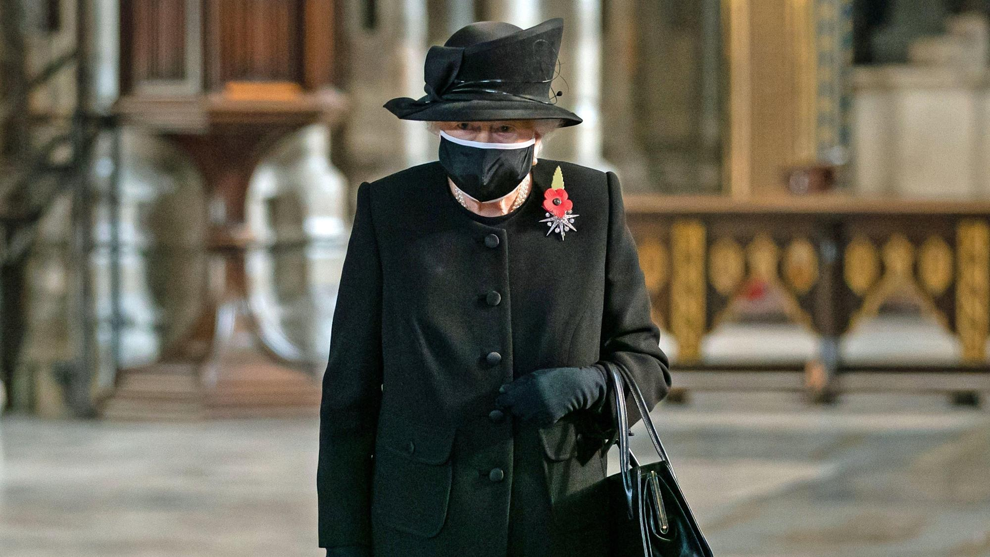 Queen wears face mask in public for first time to attend poignant ceremony