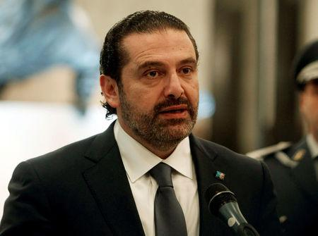 Saad al-Hariri who suspended his decision to resign as prime minister talks at the presidential palace in Baabda