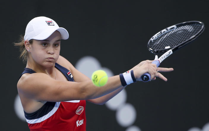 FILE - In this Jan. 10, 2019, file photo, Ash Barty of Australia hits a backhand to Elise Mertens of Belgium during their women's singles match at the Sydney International tennis tournament in Sydney. The world No. 1-ranked Barty on Thursday, Jan. 21, 2021, said she'll play in a one-day exhibition event in Adelaide on Jan. 29 which includes Serena Williams, Naomi Osaka and Simona Halep. (AP Photo/Rick Rycroft, File)