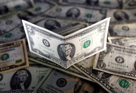 U.S. dollar notes are seen in this November 7, 2016 picture illustration. REUTERS/Dado Ruvic/Illustration/Files