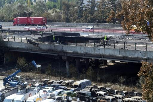 The scene where a tanker truck exploded on a motorway just outside Bologna, northern Italy, caused a section of the flyover to collapse, leaving a huge crater