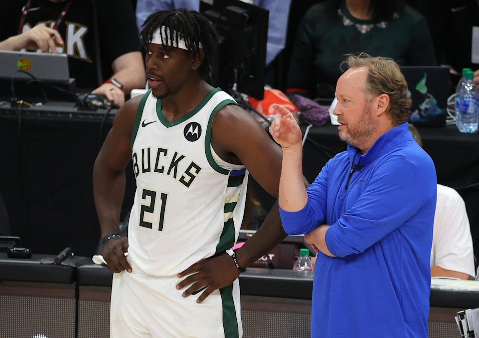 Bucks coach Mike Budenholzer must ask for more from Jrue Holiday. (Kevin C. Cox/Getty Images)