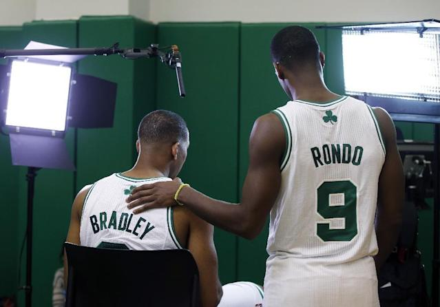 Boston Celtics guard Rajon Rondo (9) puts his hand on teammate Avery Bradley's shoulder as he is being recorded during the team's NBA basketball media day in Waltham, Mass., Monday, Sept. 30, 2013. (AP Photo/Elise Amendola)