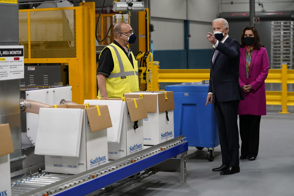 President Joe Biden and Michigan Gov. Gretchen Whitmer, right, tour a Pfizer manufacturing site, Friday, Feb. 19, 2021, in Portage, Mich. (AP Photo/Evan Vucci)