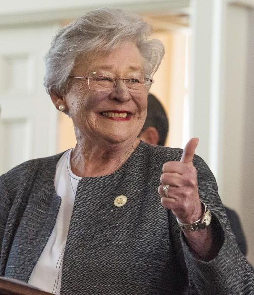 In this March 12, 2019 file photo Alabama Gov. Kay Ivey gives a thumbs up as she arrives to sign the gas tax bill in the state capitol building in Montgomery, Ala. (Mickey Welsh/The Montgomery Advertiser via AP, file)